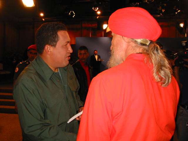 Dada Maheshvarananda presenting a copy of his Prout book to President Hugo Chávez on June 1, 2003