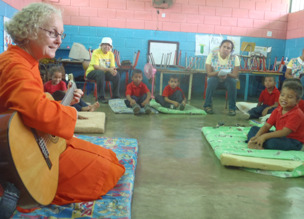 Didi Ananda Amegha, the spiritual leader of our project, singing to kids at Tartagal Preschool.
